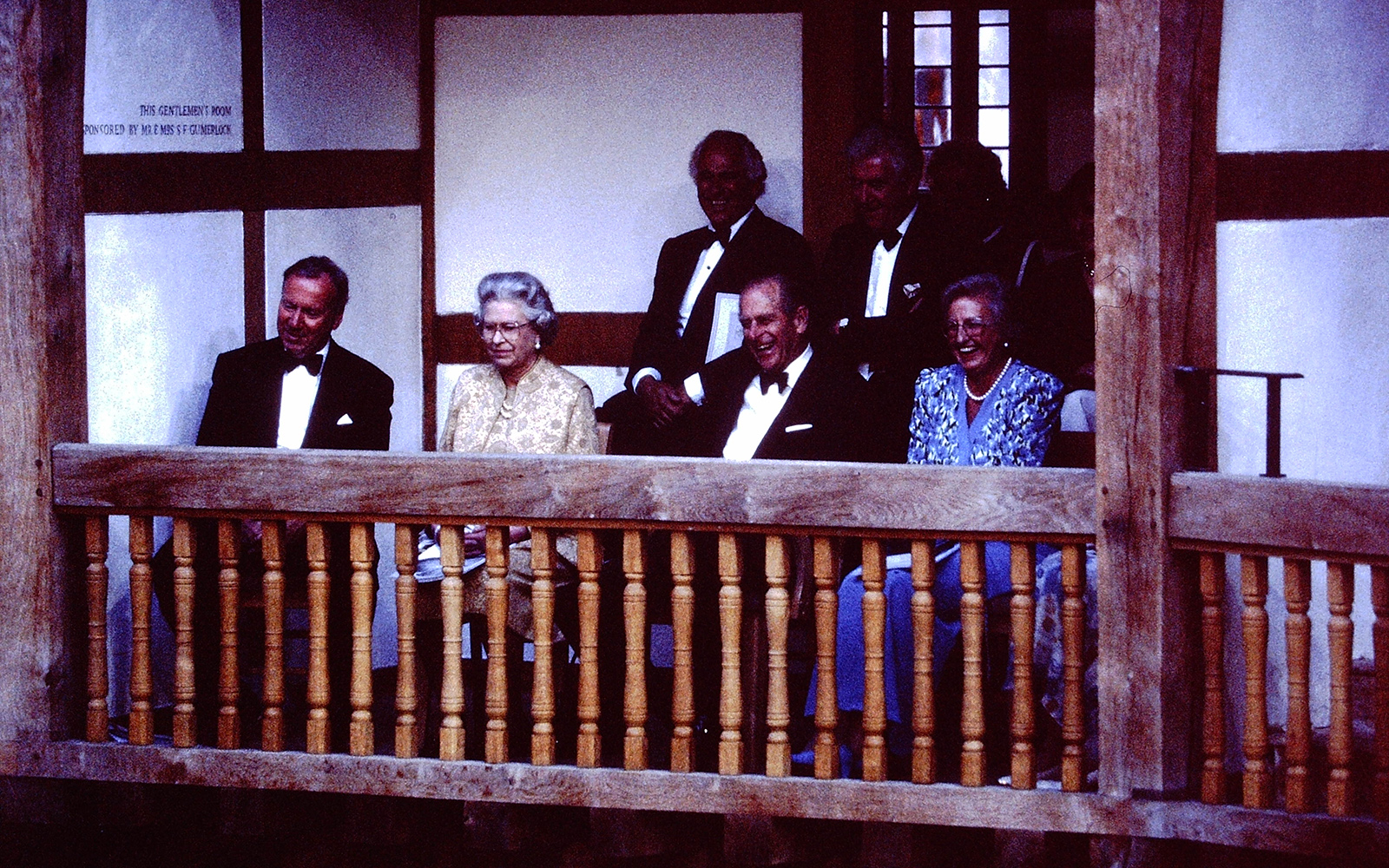 Her Majesty the Queen watches a performance in the Gentleman's Box of the Globe Theatre.