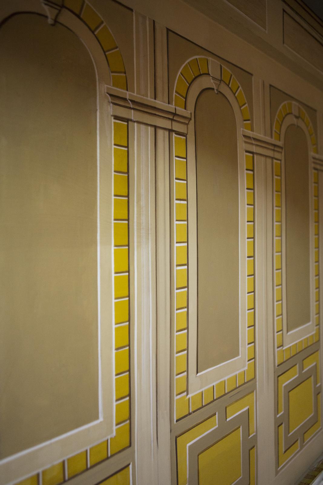 Yellow brick patterns on a wall