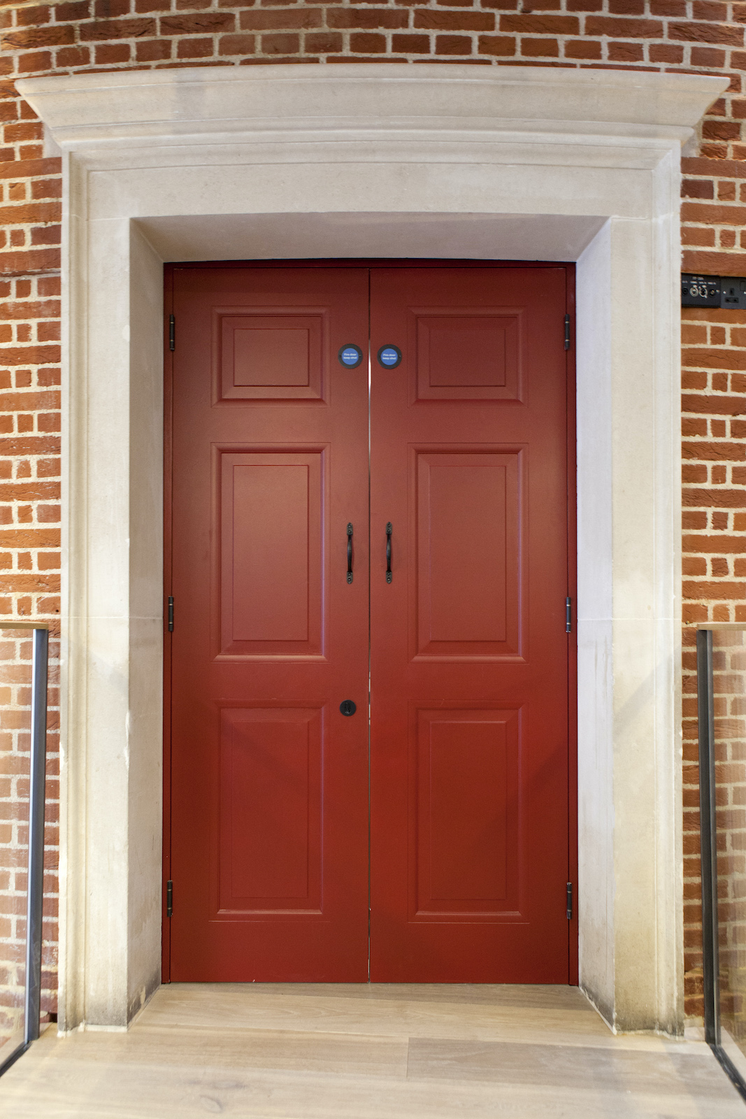 A red door with a white frame