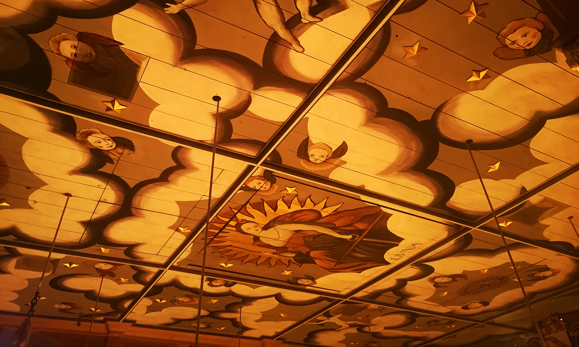Ceiling of the Sam Wanamaker Playhouse decorated with angels and clouds
