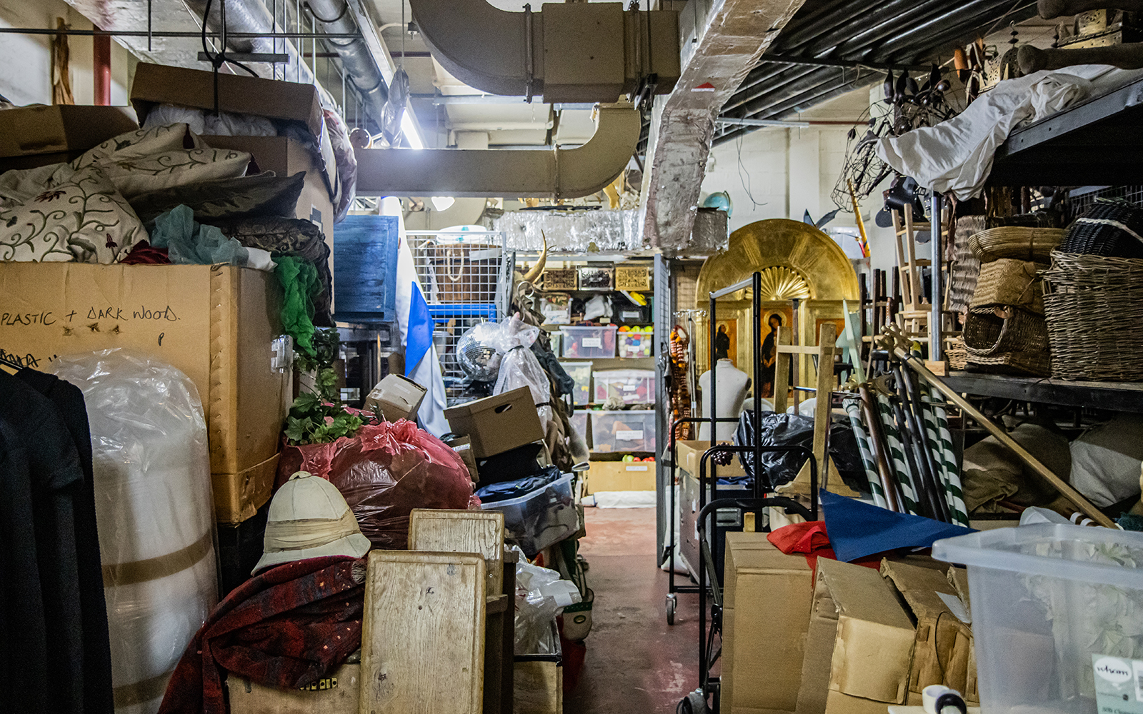 A basement heaving with stage props and costumes
