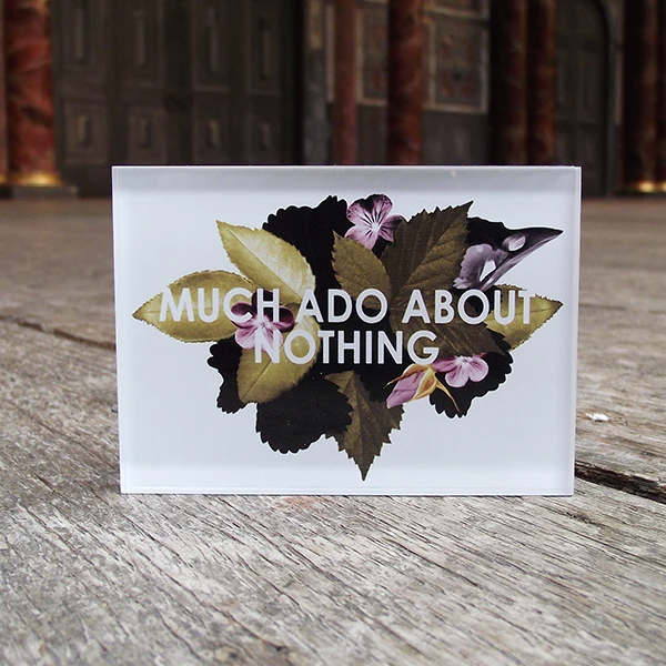 A white rectangular magnet with floral design and text reading: Much Ado About Nothing
