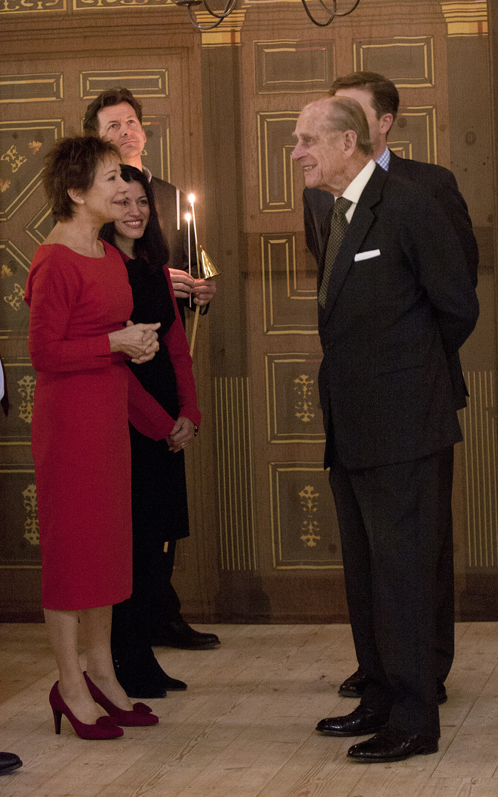 Zoe Wanamaker and His Royal Highness The Prince Philip, Duke of Edinburgh stand talking to each other in the Sam Wanamaker Playhouse.
