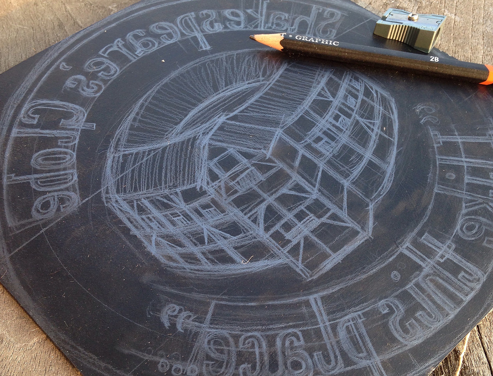 A drawing of the Globe Theatre on a block of lino, the illustration reversed.