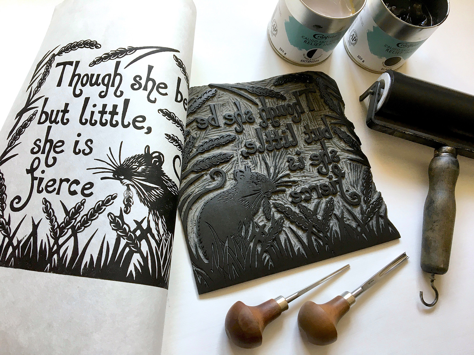 An ink print and block of a little mouse in a field with the text: Though she be but little she is fierce