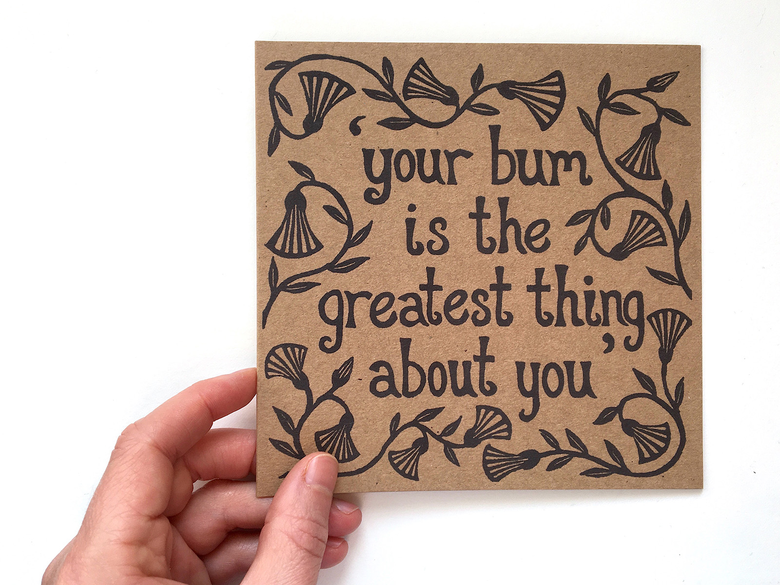 A square kraft paper greeting card with the text: Your bum is the greatest thing about you