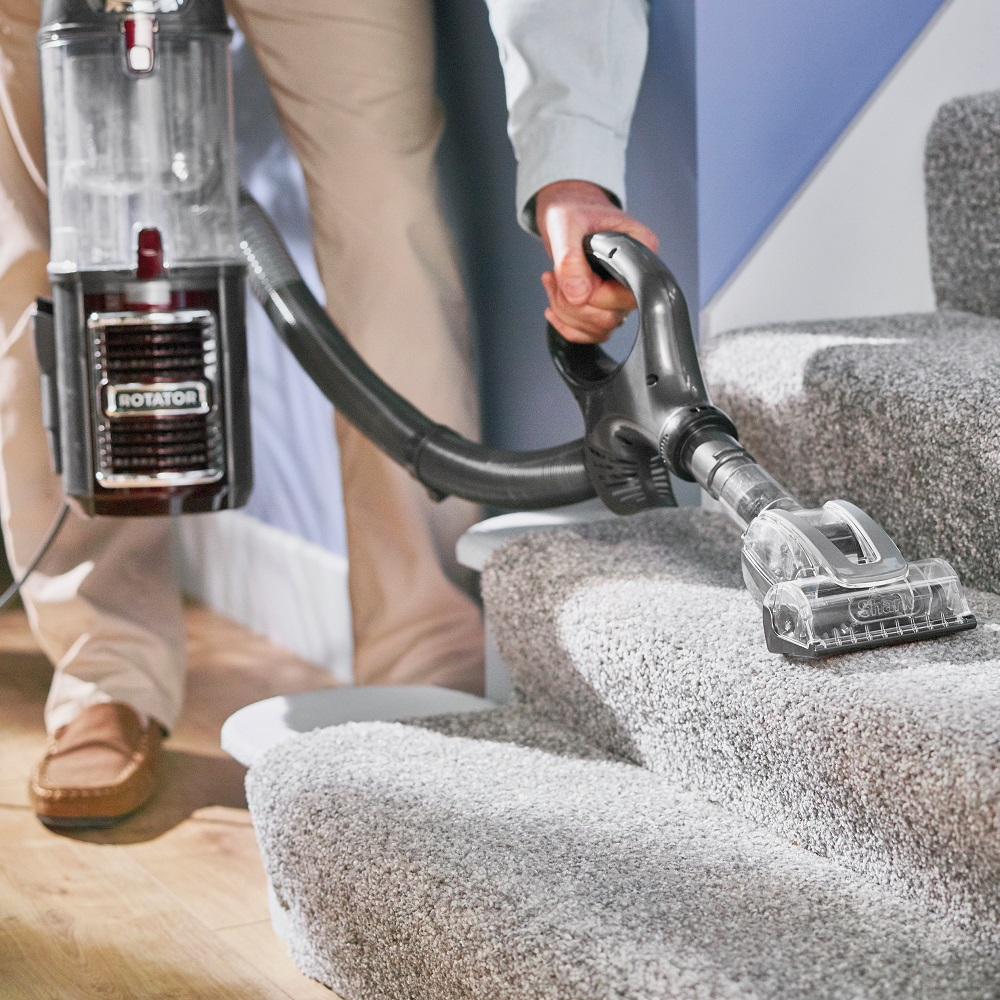 How Can I Vacuum My Carpeted Stairs Thoroughly Yet Safely