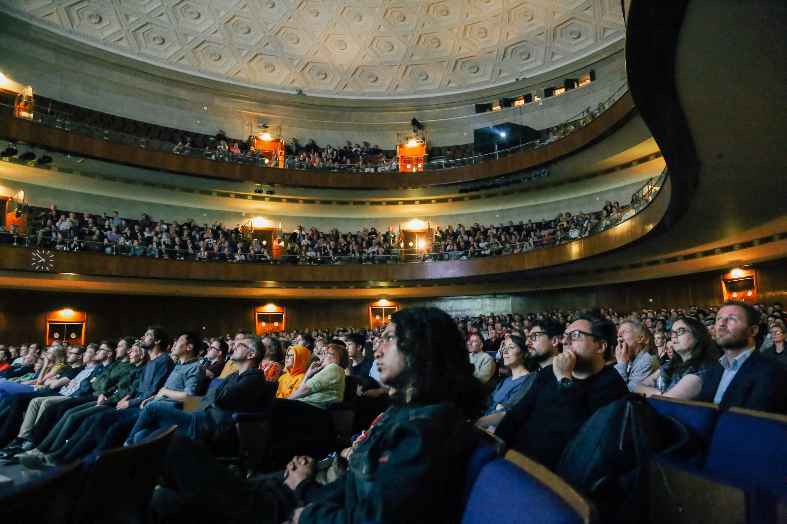 Attendees watch a film seated at Sheffield City Hall
