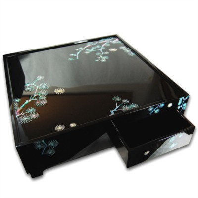 Wooden mother of pearl decorative tea table in altars, pine tree