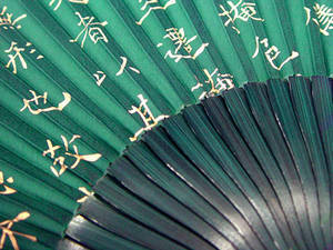 Hand held fan, green bamboo and silk, golden writing