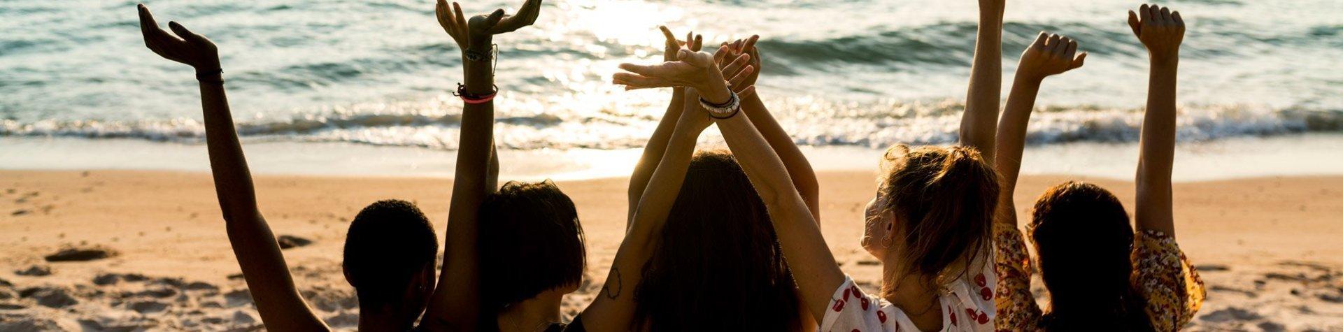 girls cheering at the beach