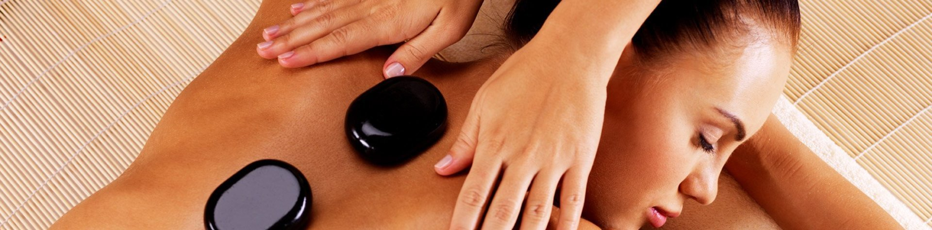 girl going for massage with hot stones