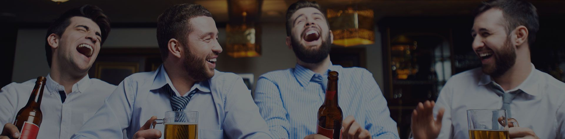 group of guys drinking beer on a stag weekend