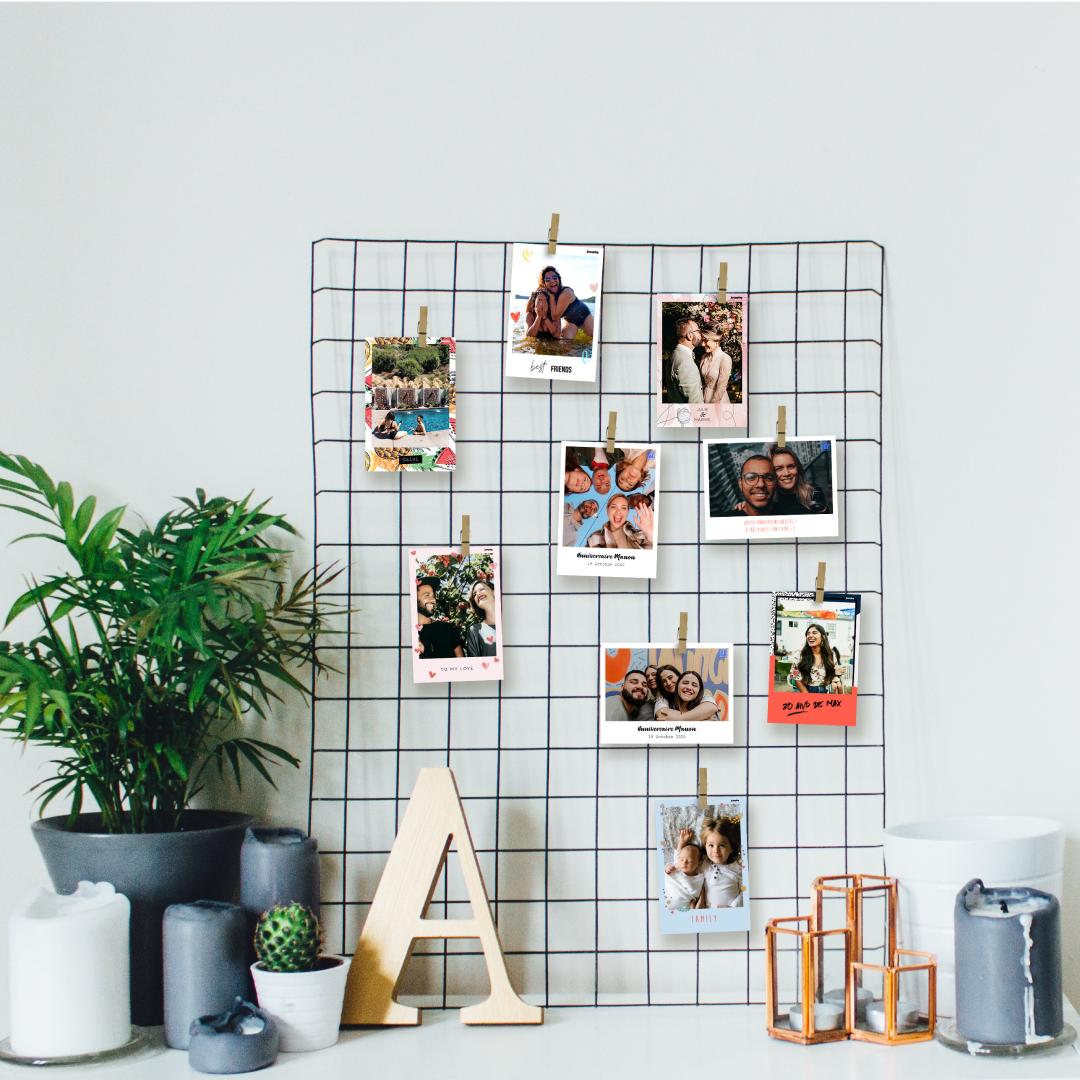 Photos imprimees par le photobooth josepho et accrochees a un panneau mural