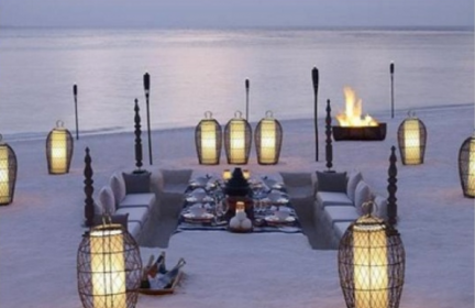 sunken beach picnic with cadle lanterns in paper and wire mesh cases