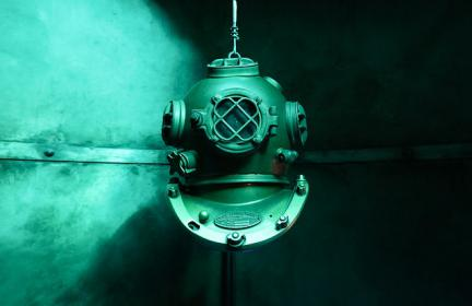 old diving helmet underwater