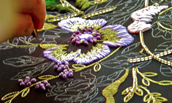 artisan working tambour thread embroidery