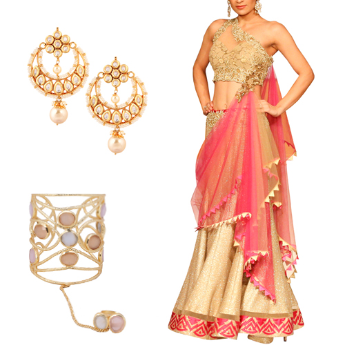 Engagement outfit option for female guests including Alluring Golden Lehenga by Mandira Wirk, Crescent Shaped Chandelier Earrings by Yosshita Neha and Jeweled Statement Cuff by Roopa Vohra.
