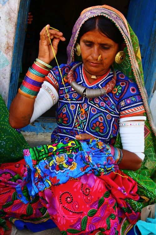 A village woman making the embroidery