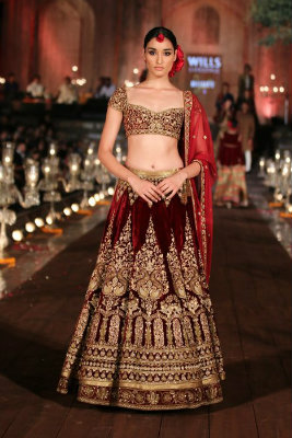 Maroon Lehenga by Rohit Bal | The Five Most Extravagant Fashion Week Outfits of all Times