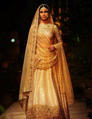Golden Lehenga by Sabyasachi Mukherjee | The Five Most Extravagant Fashion Week Outfits of all Times