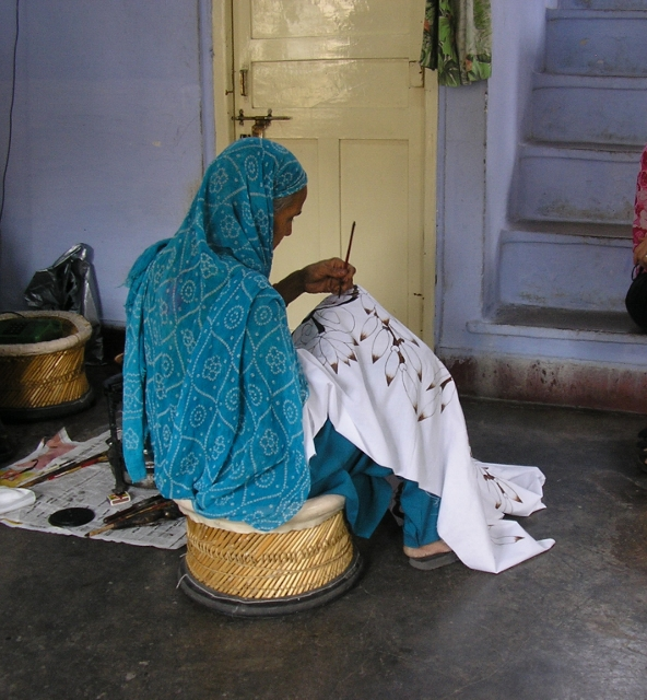 Woman painting batik with brush at BARTI, Udaipur