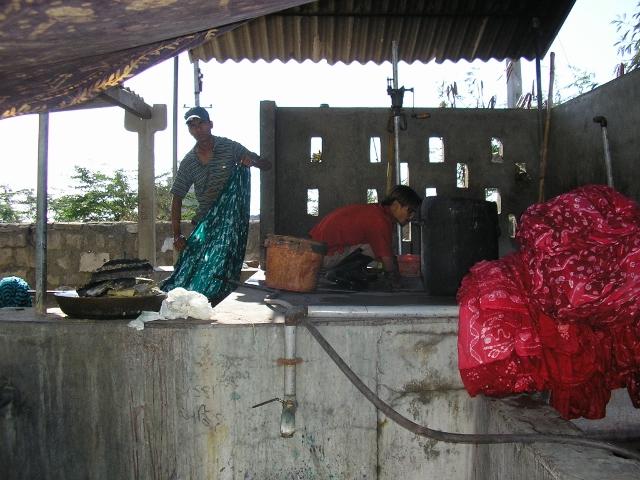 Wax printed cloth being dyed at VGS Batik, Kachchh