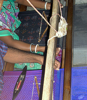 Two patola weavers weaving contemporary stoles