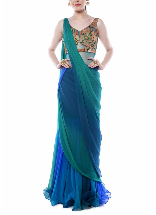 Teal green and blue brocade saree by Mandira Wirk