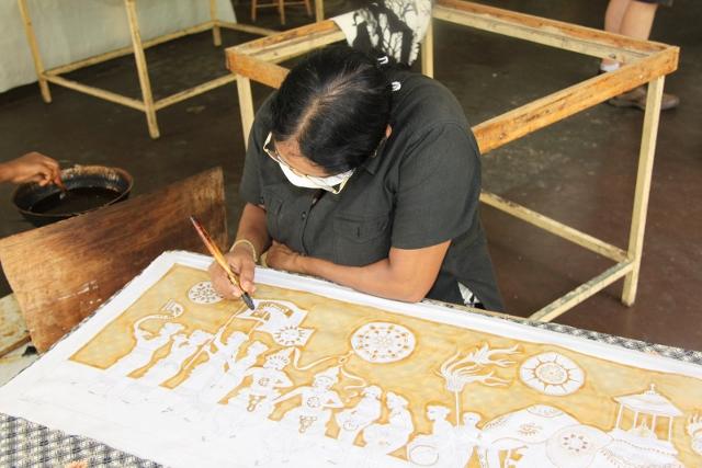 Batik painting with brush in Sri Lanka