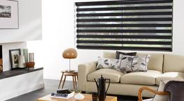Vision blinds are a unique type of blind that allow you to filter the amount of light that comes into the room without having to entirely roll the blind away. They work in the same way as roller blinds, but there are two layers of fabric with horizontal transp...