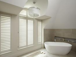 Create a contemporary look with the clean lines of our stylish Manhattan design shutters. The Manhattan range is made with a completely concealed tilting mechanism hidden within the stiles, allowing the blades to open and close simply by tilting two blades and they will all move together. The blades close in the up position, like the New England and Soho designs, and will reflect natural light back into your room whilst still providing privacy and adjustable light. The Manhattan shutter design is available in 4 different blade sizes; 64mm, 75mm, 89mm and 115mm.