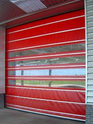 Vertical rolling fabric door. Opening/closing speed 1.2m/s. Openings up to 4000mm x 4000mm.The door differs from the 501 in that the panels roll into a top box. Minimum headroom for housing is 450mm, the door also requires a 200mm guide on each side of the acc...