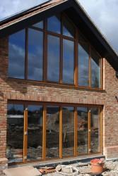 Triple glazed inward opening timber folding doors (78mm) - GreenSteps Ltd