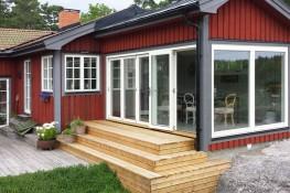 Triple glazed outward opening timber aluminium composite folding doors (76mm) - GreenSteps Ltd