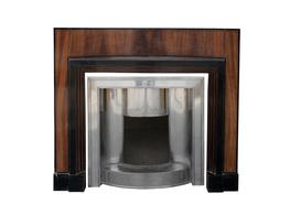 A Very interesting Art Deco Chimneypiece within different dark woods with its original c1920 polished steel decorative insert...