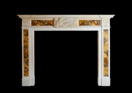 Regency chimneypiece in Statuary marble with Siena inlay and astronomical centre tablet detail....