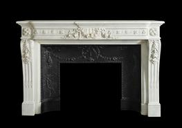 An impressive white marble Louis XVI mantel of inverted breakfront design with a beaded floral guilloche frieze and tied ribbon floral swag centre tablet, supported by tied ribbon floral console jambs with honeysuckle flutes surmounted by concentric rosette pa...
