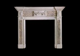 Statuary marble 18th c. chimneypiece with Siena greek key inlayed across the frieze and inlayed flutes down the jambs topped with carved rams head, swags and rosettes. The centre tablet has bold foliate carving....