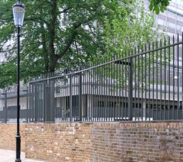 A mild steel railing fence made from vertical tubular bars with conified tops.  These pass through a pressed steel channel or RHS which is bolted to a choice of steel posts.The versatility of the system allows for stepping; the flat bar post can be drilled on...