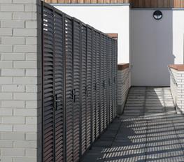 Bin stores are individually designed from a practical system of modular steel louvred panels and doors.  The robust construction provides visual screening and security, as well as ventilation and natural daylight for roofed enclosures, and is hot-dip galvanize...