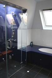 Bespoke frameless <strong>shower enclosures</strong> in restricted spaces image