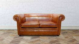 The Chesterfield 1930's Classic Sofa. The Chesterfield Leather Sofa with it's unique  Low Back Style, Smooth Leathered Arms and Back complemented with a Front Border. The Scroll Fronted arms on the Chesterfield Leather Sofa are attractively embellished with li...