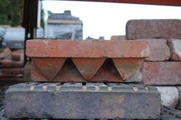 A good quality, large batch of stretcher corbels. These bricks are usually used as a string course on the exterior of a building....