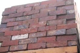 A Wire cut 'Brindle Brick' containing shades of red & purple. ...