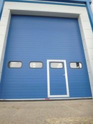 Each door is counterbalanced by means of tempered helical springs at high level, mounted on bright steel plates with self aligning roller bearings for smooth quiet operation. Cable tensioning devices are fitted as standard to all doors. Rubber seals are fitted...