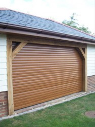 Powered domestic garage door roller shutter which combines all the advantages and conveniences of a power operated rolling shutter with the required aesthetics of a garage door. It is designed to improve on many of the qualities of both sectional overhead door...