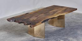We are constantly searching and collecting interesting timber to make outstanding pieces of furniture. The table shown is made from a stunning piece of English Walnut. We've used a matched pair of boards in combination with polished legs made from gilding meta...