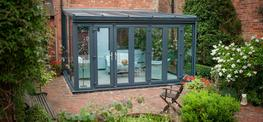 The Ascot Conservatory is perhaps the ultimate modern 'glass room'; allowing uninterrupted views of your garden whilst staying warm and snug year-round thanks to the technically advanced frames and glass. Moving away from the traditional with a darker colo...