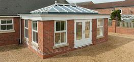 The desire to create more than just an extra room, the Hazlemere designers of this aluminium double glazed Sandhurst Orangery ensure the new blended with the old to totally transform the interior living space. Designed to be easily built on to a low level roof...